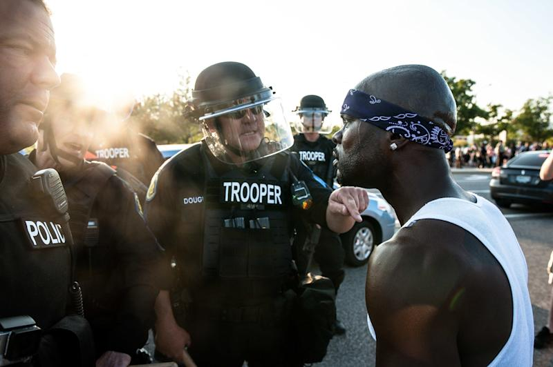 Riot police keep protesters from marching down Brentwood Boulevard in Clayton, Missouri, on Wednesday. (Joseph Rushmore for HuffPost)