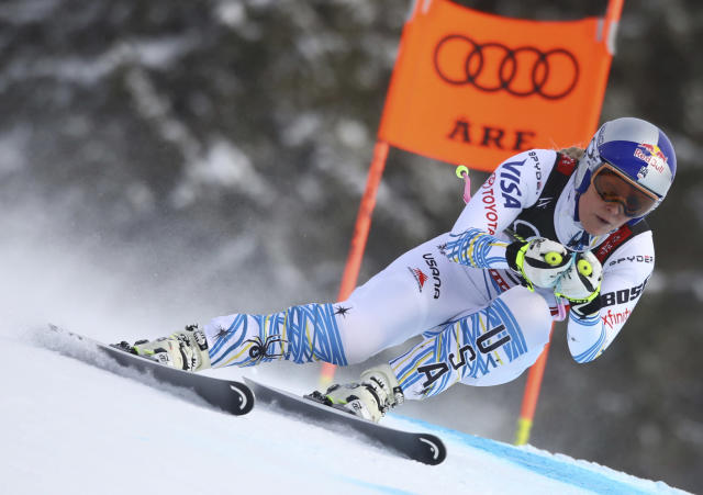 Lindsey Vonn speeds down the course during the women's downhill race, at the alpine ski World Championships in Are, Sweden, Sunday, Feb. 10, 2019. (AP Photo/Alessandro Trovati)