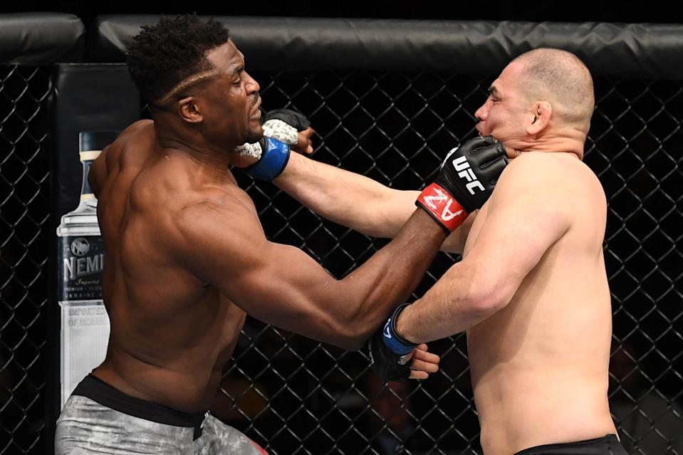 Francis Ngannou and Cain Velasquez exchange punches during UFC Fight Night at Talking Stick Resort Arena on Feb. 17, 2019 in Phoenix, Arizona. (Getty Images)