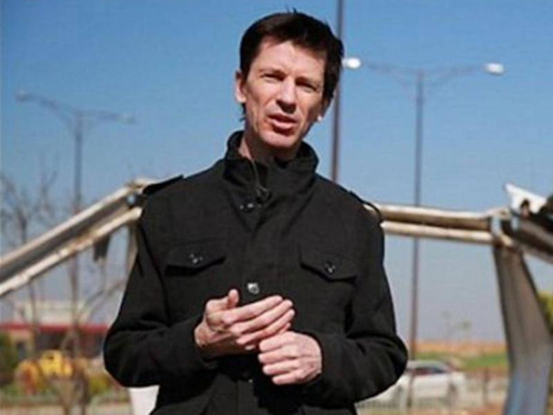 British hostage John Cantlie was shown in a series of Isis propaganda videos before disappearing during the battle of Mosul (AP)