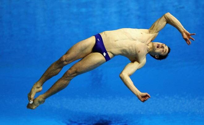 LONDON, ENGLAND - FEBRUARY 22:  Reuben Ross of Canada dives in the Men's 3m Springboard Final during day three of the 18th FINA Visa Diving World Cup - LOCOG Test Event for London 2012 at the Aquatics Centre on February 22, 2012 in London, England.  (Photo by Bryn Lennon/Getty Images)