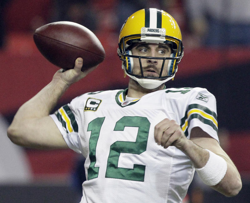 Green Bay Packers quarterback Aaron Rodgers passes against the Atlanta Falcons during the second half of an NFL divisional playoff football game, Saturday, Jan., 15, 2011, in Atlanta. (AP Photo/Patrick Semansky)