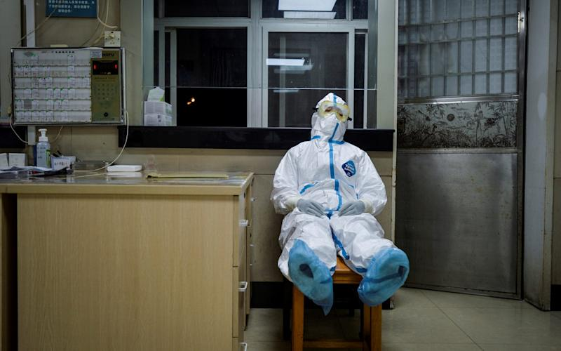 A health worker in Wuhan takes a break - Reuters/China Daily
