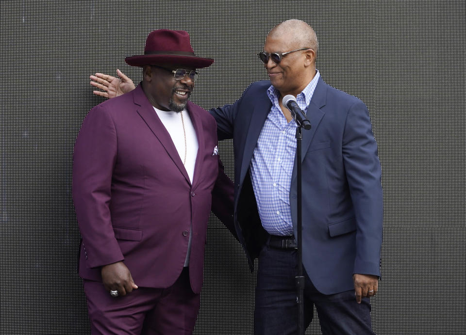 Cedric the Entertainer, left, host of Sunday's 73rd Primetime Emmy Awards, is greeted by executive producer Reginald Hudlin during the show's Press Preview Day, Wednesday, Sept. 14, 2021, at the Television Academy in Los Angeles. The awards show honoring excellence in American television programming will be held at the Event Deck at L.A. Live. (AP Photo/Chris Pizzello)