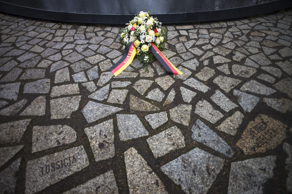 Flowers are placed at the Memorial to the Sinti and Roma Victims of the Holocaust on the International Holocaust Remembrance Day, in Berlin, Germany, Wednesday, Jan. 27, 2021. (AP Photo/Markus Schreiber)