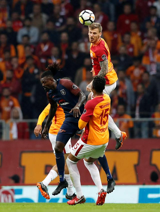 Soccer Football - Turkish Super League - Galatasaray vs Basaksehir - Turk Telekom Arena, Istanbul, Turkey - April 15, 2018 Galatasaray's Serdar Aziz in action with Istanbul Basaksehir's Emmanuel Adebayor REUTERS/Murad Sezer