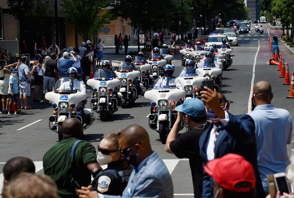 <p>The funeral procession for Congressman and civil rights leader John Lewis(D-GA) arrives at Black Lives Matter Plaza in Washington, DC, on July 27, 2020.</p>