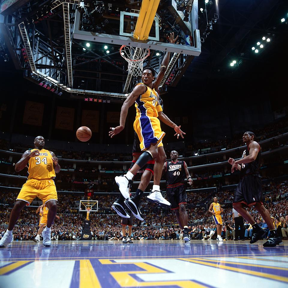 The Kobe-Shaq connection reached its apex in 2001, when Bryant and O'Neal nearly led the Lakers to a perfect postseason. The historic playoff run included sweeps of Western Conference rivals Portland, Sacramento and San Antonio en route to meeting Allen Iverson and Philadelphia in the Finals. (Andrew D. Bernstein/NBAE via Getty Images)