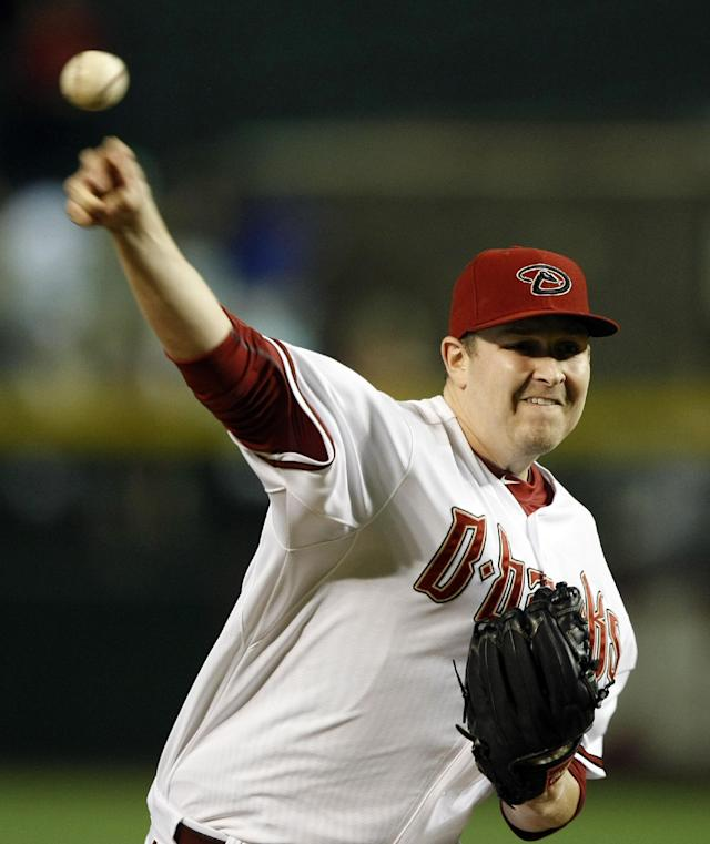 Arizona Diamondbacks relief pitcher Trevor Cahill (35) throws in the first inning during a baseball game against the Los Angeles Dodgers, Tuesday, Aug. 26, 2014, in Phoenix. (AP Photo/Rick Scuteri)
