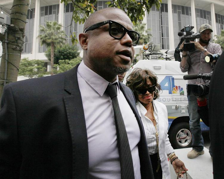 Randy Jackson and Rebbie Jackson, background right, brother and sister of late pop star Michael Jackson, arrive at a courthouse for Katherine Jackson's lawsuit against concert giant AEG Live in Los Angeles, Monday, April 29, 2013. An attorney for Michael Jackson's mother says AEG Live owed it to the pop superstar to properly investigate the doctor held criminally responsible for his death. (AP Photo/Nick Ut)