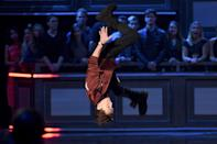 <p>Tom Holland flips onstage during the 2017 MTV Movie And TV Awards at The Shrine Auditorium on May 7, 2017 in Los Angeles, California.</p>