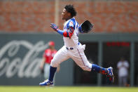 Atlanta Braves center fielder Ronald Acuna Jr. (13) races to second for a double in the first inning of a baseball game against the Cincinnati Reds, Sunday, Aug.4, 2019, in Atlanta. (AP Photo/Todd Kirkland)