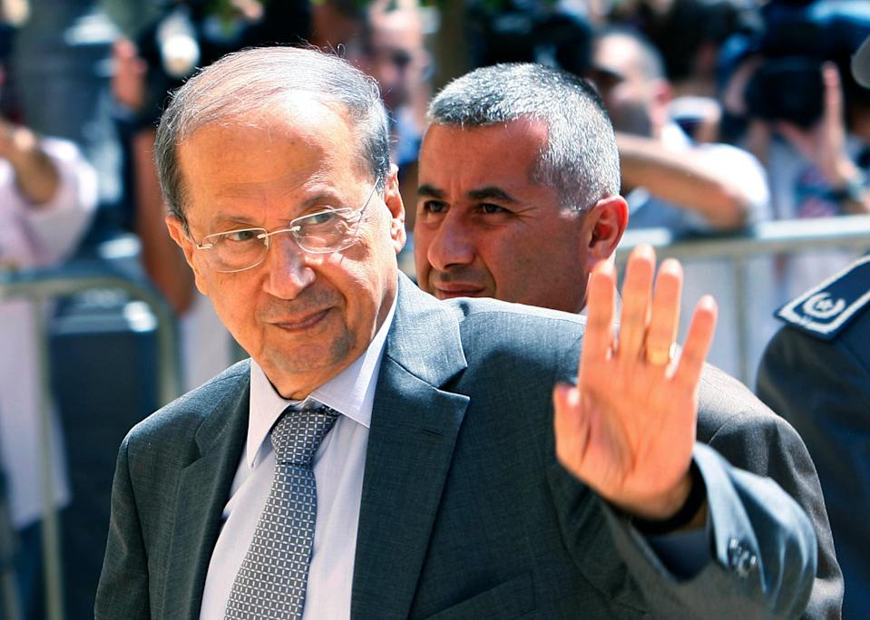 In this Thursday, June 25, 2009, file photo, Lebanese Christian leader lawmaker Michel Aoun gestures as he arrives at the Parliament for the election of the house speaker in Beirut, Lebanon