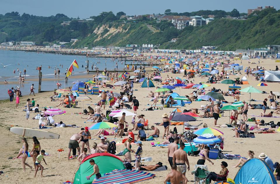 People enjoying the hot weather at Bournemouth Beach in Dorset (Andrew Matthews/PA) (PA Wire)