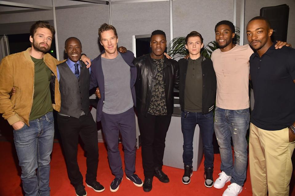 <p>Super fanboy John Boyega (center) couldn't resist meeting Marvel heroes Sebastian Stan (Winter Soldier), Don Cheadle (War Machine), Benedict Cumberbatch (Dr. Strange), Tom Holland (Spider-Man), Chadwick Boseman (Black Panther), and Anthony Mackie (Falcon). (Photo: Getty Images for Disney) </p>