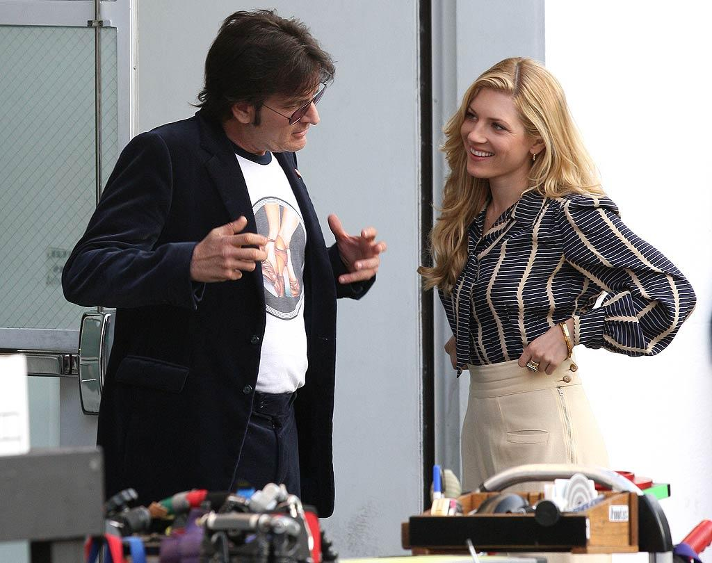 """Is Charlie -- donning a velvet suit as part of his '70s wardrobe -- actually trying to charm attractive co-star Katherine Winnick (""""Bones"""") or is he just rehearsing?  (11/15/2011)"""