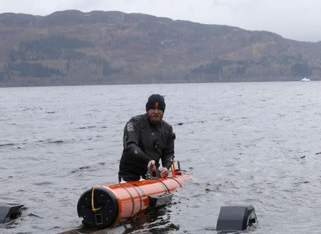 Subsea engineer John Haig launches Munin, an intelligent marine robot, to explore Loch Ness in Scotland, Britain April 13, 2016.  REUTERS/Russell Cheyne