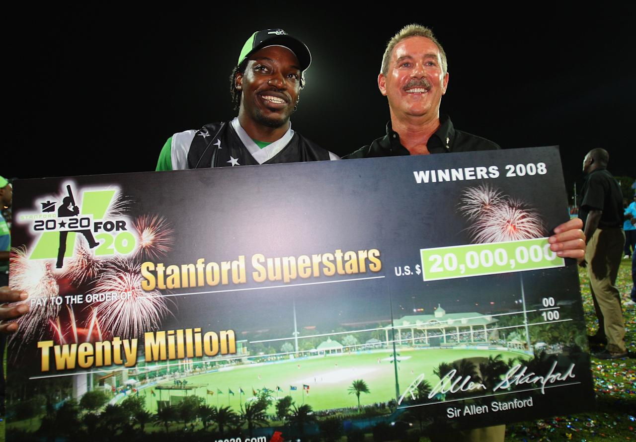 ST. JOHN'S, ANTIGUA AND BARBUDA - NOVEMBER 01:  Chris Gayle of the Superstars and Sir Allen Stanford pose with the chegue during the Stanford Twenty20 Super Series 20/20 for 20 match between Stamford Superstars and England at the Stanford Cricket Ground on November 1, 2008 in St Johns, Antigua. (Photo by Tom Shaw/Getty Images)
