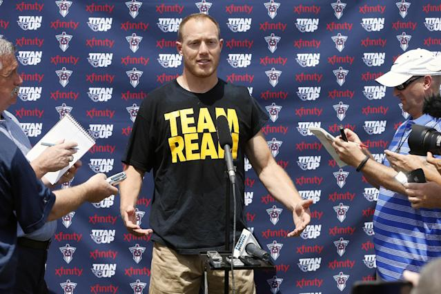 Former Tennessee Titans linebacker Tim Shaw answers questions at the Titans NFL football practice facility on Wednesday, Aug. 20, 2014, in Nashville, Tenn. Shaw has announced that he has ALS, and visited the facility where the Titans players, coaches and staff took part in the Ice Bucket Challenge by pouring ice water over their heads to raise money and awareness to battle the disease. (AP Photo/Mark Humphrey)