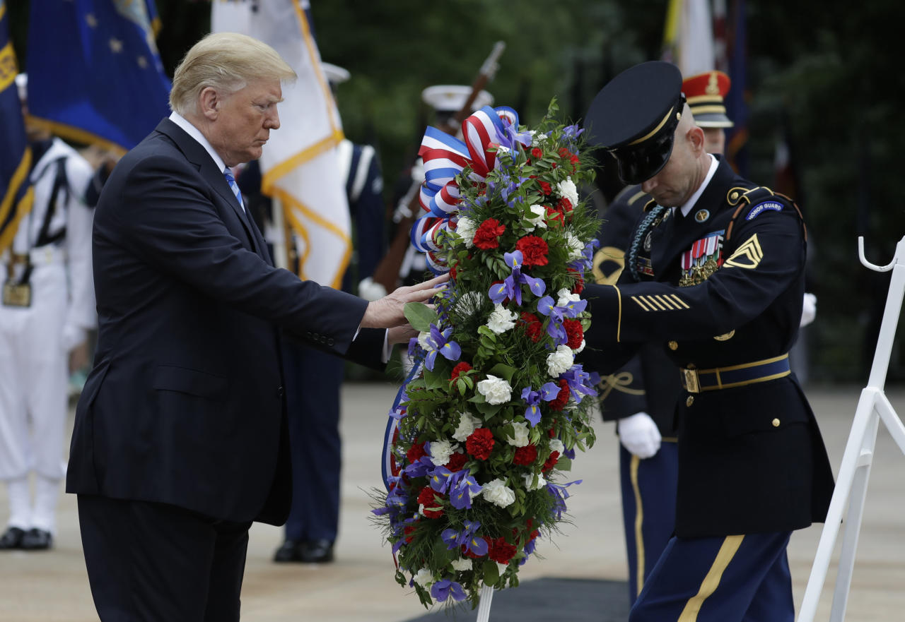 <p>President Donald Trump lays a wreath at the Tomb of the Unknown Solider at Arlington National Cemetery, Monday, May 28, 2018, in Arlington, Va. (Photo:Evan Vucci/AP) </p>