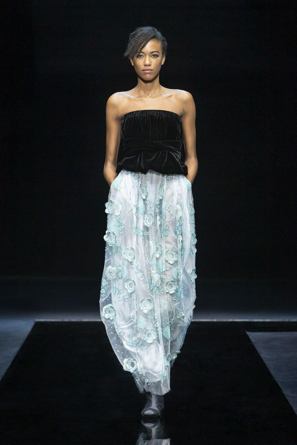 "<p>Giorgio Armani's autumn/winter 2021 collection was entitled 'Nocturnal', and embraced gentle, romantic touches with a colour palette of pale purples and pinks, as well as watery hues and turquoise shimmers. ""The male-female contrast is a dialogue between night and day, with blacks mixed with blues, luminous flashes, velvet bows.""<br></p>"