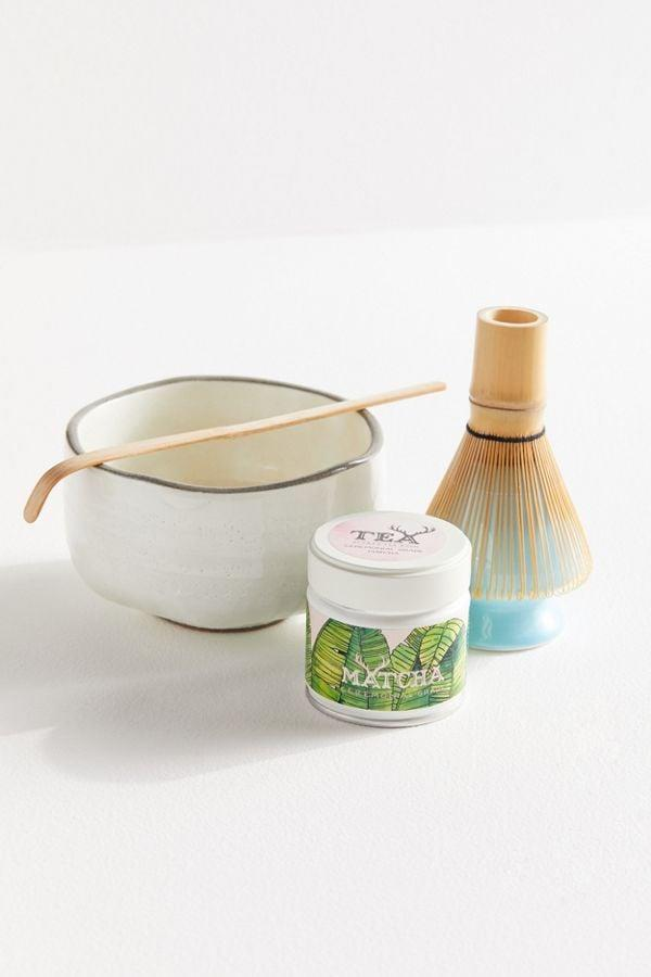 """<p>Matcha provides energy without the caffeine jitters, and thanks to this <a href=""""https://www.popsugar.com/buy/Alfred-Tea-Room-Ceremonial-Matcha-Gift-Set-505429?p_name=Alfred%20Tea%20Room%20Ceremonial%20Matcha%20Gift%20Set&retailer=urbanoutfitters.com&pid=505429&price=84&evar1=fit%3Aus&evar9=44197265&evar98=https%3A%2F%2Fwww.popsugar.com%2Ffitness%2Fphoto-gallery%2F44197265%2Fimage%2F46794641%2FAlfred-Tea-Room-Ceremonial-Matcha-Gift-Set&list1=gifts%2Cgift%20guide%2Chealthy%20living%2Cfitness%20gifts%2Cgifts%20for%20women&prop13=mobile&pdata=1"""" rel=""""nofollow"""" data-shoppable-link=""""1"""" target=""""_blank"""" class=""""ga-track"""" data-ga-category=""""Related"""" data-ga-label=""""https://www.urbanoutfitters.com/shop/alfred-tea-room-ceremonial-matcha-gift-set?category=SHOPBYBRAND&amp;color=067"""" data-ga-action=""""In-Line Links"""">Alfred Tea Room Ceremonial Matcha Gift Set</a> ($84), they can make lattes at home!</p>"""