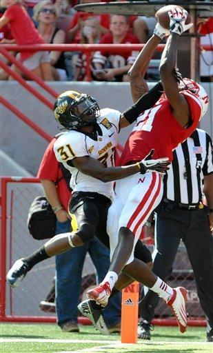 Nebraska's Jeremy Hester (21) grabs a touchdown pass in front of Southern Miss's Alexander Walters (31) during an NCAA college football game, Saturday, Sept 1, 2012, in Lincoln, Neb. (AP Photo/Dave Weaver)