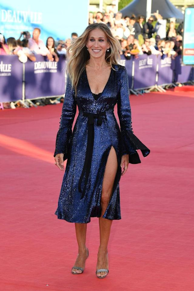 <p>Sarah Jessica Parker channelled Carrie Bradshaw on the red carpet in Deauville on September 6 courtesy of a seriously sparkly thigh-split dress. <em>[Photo: Getty]</em> </p>