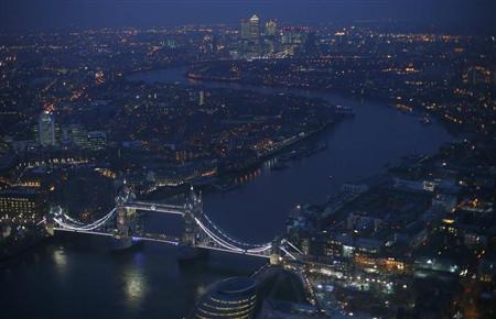 Tower Bridge and the Canary Wharf financial district are seen at dusk in an aerial photograph from The View gallery at the Shard, western Europe's tallest building, in London