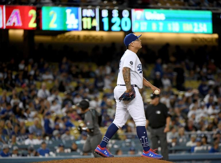 Los Angeles Dodgers pitcher Julio Urias, seen here in an August 9 Major League Baseball game, has been banned 20 games for violating MLB's domestic violence policy