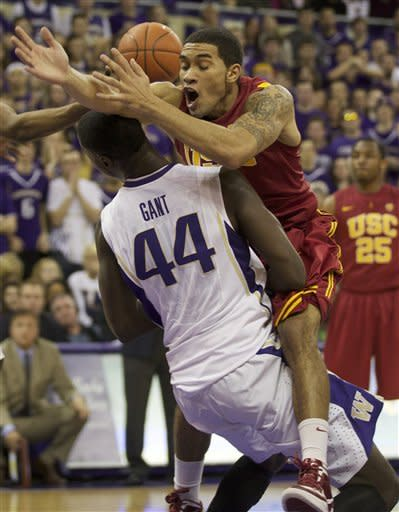 Greg Allen, right, of USC collides with Washington's Darnell Gant in an NCAA college basketball game at Alaska Airlines Arena in Seattle Saturday Feb. 4, 2012. (AP Photo/Stephen Brashear)