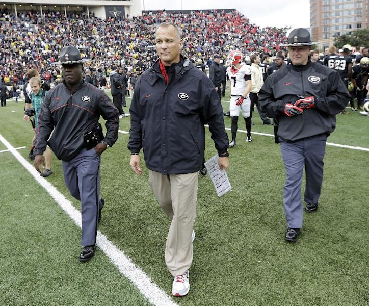 Georgia head coach Mark Richt, center, leaves the field after losing to Vanderbilt 31-27 in an NCAA college football game on Saturday, Oct. 19, 2013, in Nashville, Tenn. (AP Photo/Mark Humphrey)
