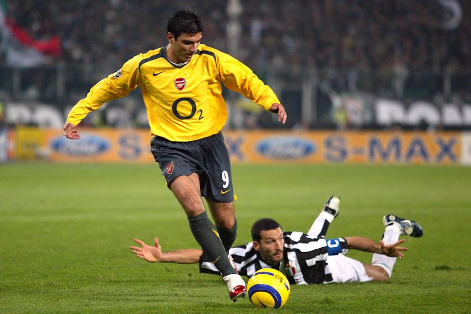 Juventus' Gianluca Zambrotta (r) takes a tumble after a challenge by Arsenal's Jose Antonio Reyes  (Photo by Mike Egerton - EMPICS/PA Images via Getty Images)