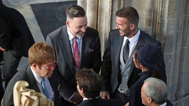 PHOTO: David and Victoria Beckham talk with Sir Elton John, left, and David Furnish as they arrive for the wedding ceremony of Prince Harry and Meghan Markle at St. George's Chapel in Windsor Castle in Windsor, May 19, 2018. (Danny Lawson/AP)