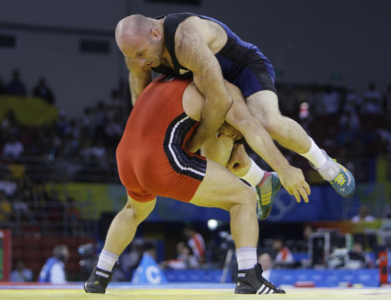 Tajikistan's Yusup Abdusalamov, below, wrestles Georgia's Revazi Mindorashvili in a gold medal 84kg freestyle match at the 2008 Olympics in Beijing, Thursday, Aug. 21, 2008. Mindorashvili won the gold.  (AP Photo/David Guttenfelder)