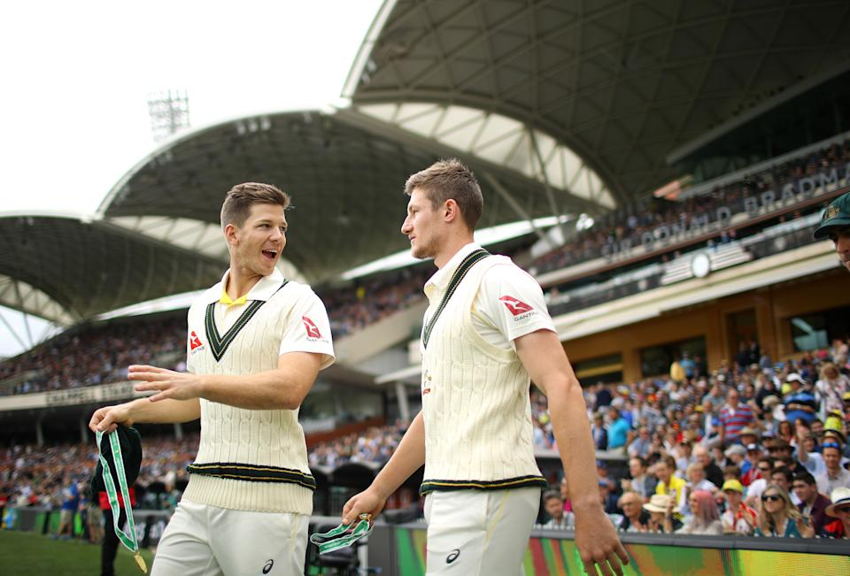 Tim Paine (pictured left) talks to team mate Cameron Bancroft (pictured right) ahead of play.
