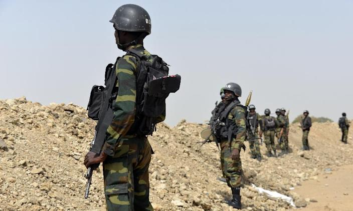 Cameroonian soldiers patrol in the town of Fotokol, on the border with Nigeria, on February 17, 2015, after clashes with Nigeria-based Boko Haram insurgents (AFP Photo/Reinnier Kaze)