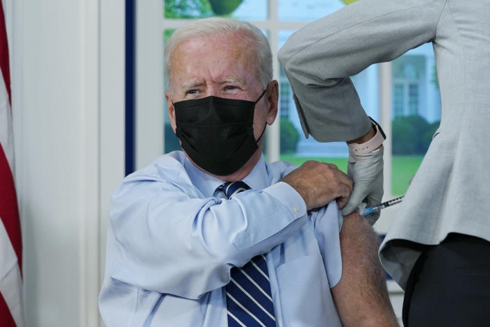 President Joe Biden receives a COVID-19 booster shot during an event in the South Court Auditorium on the White House campus, Monday, Sept. 27, 2021, in Washington. (AP Photo/Evan Vucci)