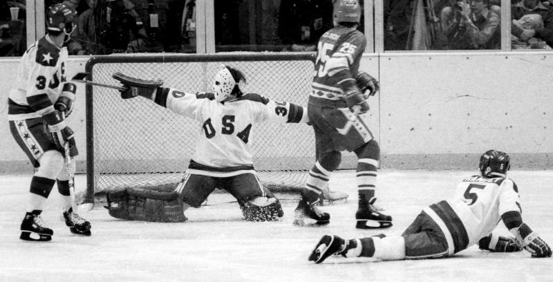"In this Feb. 22, 1980, photo, United States goalie Jim Craig sprawls to make a save on the Soviet Union's Vladimir Golikov during a medal-round game at the Winter Olympics in Lake Placid, N.Y. Tourism is a $1.2 billion industry in the Lake Placid region, much of it still fueled by the memory of the U.S. hockey team beating the Soviet Union as the ""Miracle on Ice"" highlight of the 1980 Olympic Games. (Tom Sweeney/Star Tribune via AP)"