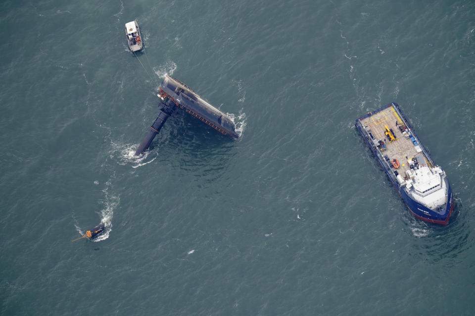 Rescue boats are seen next to the capsized lift boat Seacor Power seven miles off the coast of Louisiana in the Gulf of Mexico Sunday, April 18, 2021. The vessel capsized during a storm on Tuesday. (AP Photo/Gerald Herbert)