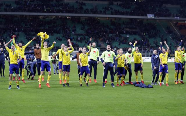 Sweden's players celebrated like crazy after beating Italy on aggregate to reach the World Cup. (AP)
