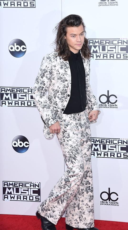 <p>Speaking of that floral Gucci suit that's been called his worst outfit ever, this is it. Harry's been known to rock a patterned suit or two (or 12). He eased into his more flashy fashion while still in One Direction, but if you ask me, if was this Gucci suit he wore to the 2015 American Music Awards that really thrust him into the loud print game. Since then, he's gone full force into wearing sequined, glittery, floral, and even flared-pants suits.</p>