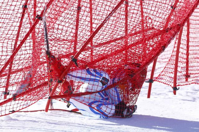 Romania's Ioan Valeriu Achiriloaie crashes into the safety nets during the downhill run of the men's alpine skiing super combined event at the 2014 Sochi Winter Olympics at the Rosa Khutor Alpine Center February 14, 2014. REUTERS/Ruben Sprich (RUSSIA - Tags: SPORT SKIING OLYMPICS TPX IMAGES OF THE DAY)