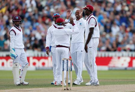 Cricket - England vs West Indies - First Test - Birmingham, Britain - August 18, 2017 West Indies' Roston Chase celebrates the wicket of England's Ben Stokes with team mates Action Images via Reuters/Paul Childs