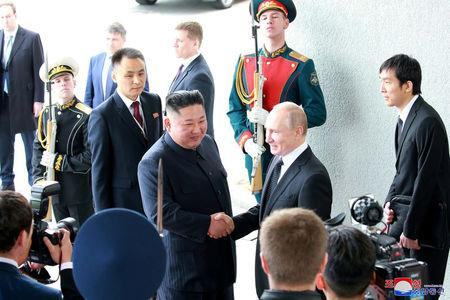 North Korean leader Kim Jong Un shakes hands with Russian President Vladimir Putin in Vladivostok