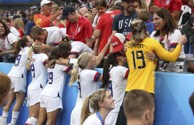 Players of USA meet their families and friends following the 2019 FIFA Women's World Cup France Final match between The United States of America and The Netherlands at Stade de Lyon on July 7, 2019 in Lyon, France. (Photo by Jean Catuffe/Getty Images)
