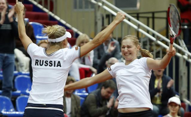 Russia's Ekaterina Makarova, right, and Elena Vesnina celebrate their victory over Slovakia's Dominika Cibulkova and Daniela Hantuchova at the Fed Cup match in Moscow, Russia, Sunday, April 21, 2013. Russia won 3-2. (AP Photo/Misha Japaridze)