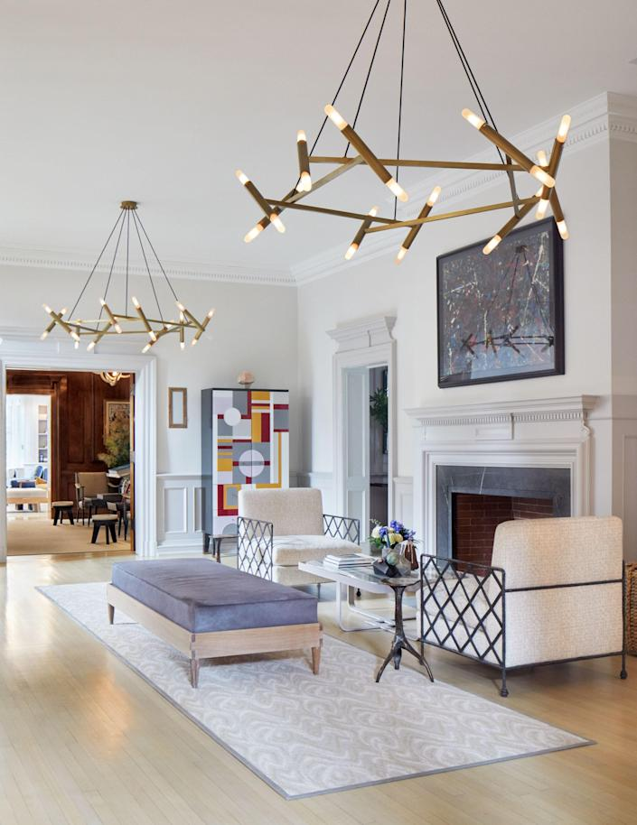 """""""The main floor is unique in that there are no hallways or circulation zones,"""" Newman explains. To that end, furniture and lighting were carefully placed to help create a """"visual hallway [that] reinforces the length."""""""