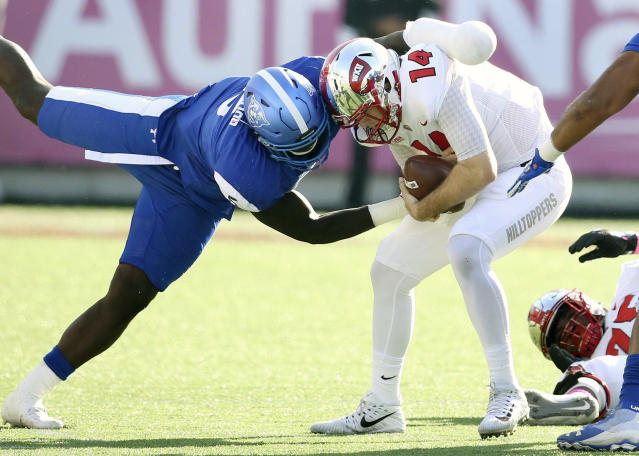 "Georgia State defensive end Mackendy Cheridor (L) sacks Western Kentucky's <a class=""link rapid-noclick-resp"" href=""/ncaaf/players/227602/"" data-ylk=""slk:Mike White"">Mike White</a> during the first half of the Cure Bowl on Saturday. (AP)"