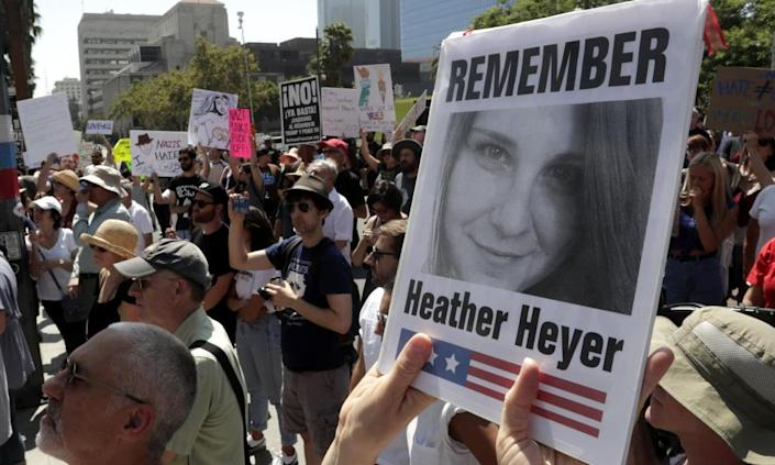 """<span class=""""element-image__caption"""">A demonstrator holds up a photo of Heather Heyer during a demonstration against racism in Los Angeles. The Unite the Right rally where Heyer was killed started as a Facebook event.</span> <span class=""""element-image__credit"""">Photograph: Mike Nelson/EPA</span>"""